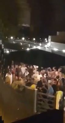 Video footage shows hundred of pub goers crammed into the beer garden